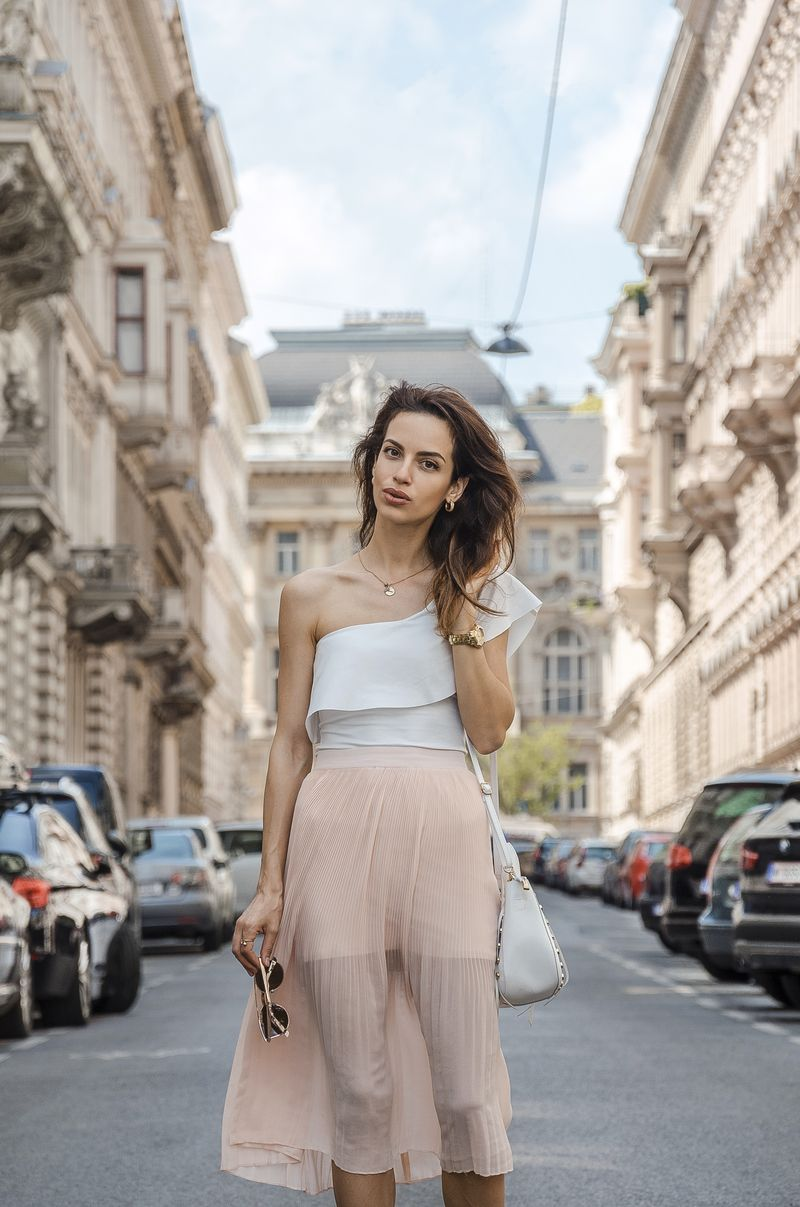 Discovering Vienna in Pleated Blush Skirt in and One Shoulder Top